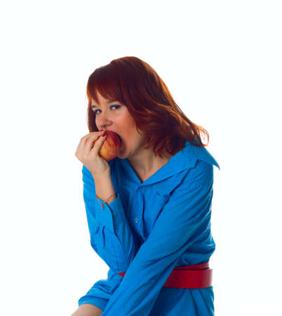 Healthy woman takes a bite out of an apple Stock Photo - 4300368
