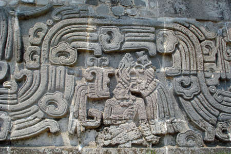 The Toltec Temple of the Feathered Serpent with stylized depictions in Xochicalco, Mexico