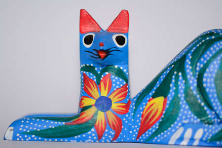 Colorful cat alebrije, Mexican artcraft close up photo