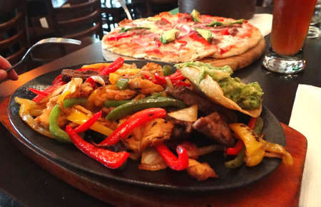 tex: Delicious dinner mexican fajitas and mexican pizza