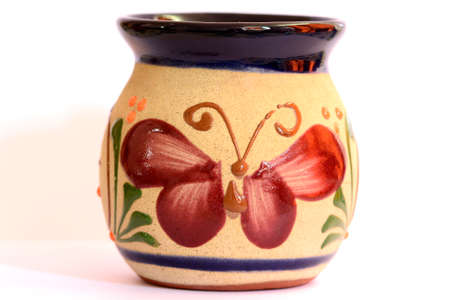 handimade: Mexican pottery, cup with butterfly decoration Stock Photo