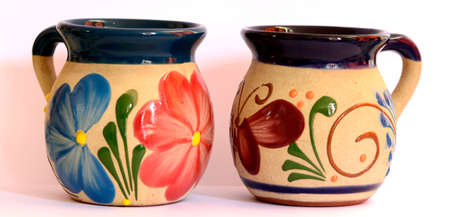 Mexican pottery, two traditional cups, flower and butterfly