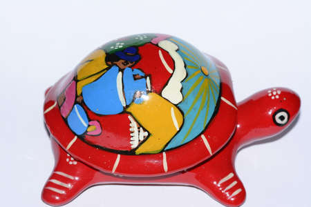 folkloristic: Colorful Mexican ethnic turtle clay artcraft Stock Photo