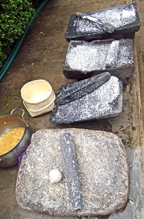 Metate, metlatl or mealing stone for corn in Mexico