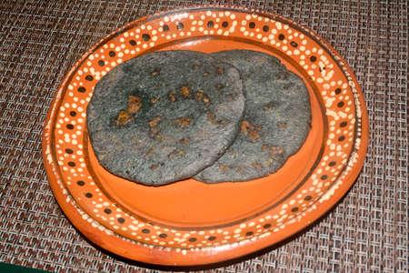 Blue corn and pork make Mexican traditional dish gorditas Stock Photo