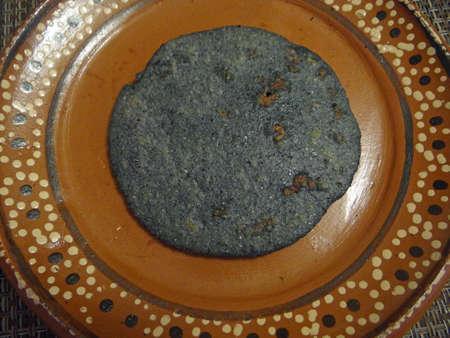 メキシコ gordita トウモロコシと豚肉でいっぱい