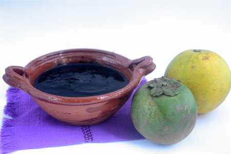 メキシコの伝統的な黒シロサポテ甘いオレンジ ジュースで作られました。 写真素材