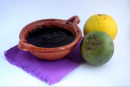 Mexican traditional black sapote sweet made with orange juice
