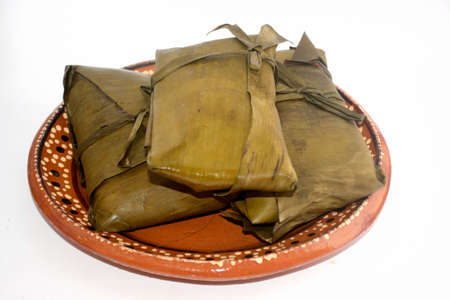 Mexican chipilin tamales from Chiapas on dish for Candelaria Day celebration 版權商用圖片