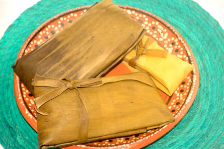 Mexican tamales on dish for Candelaria Day celebration