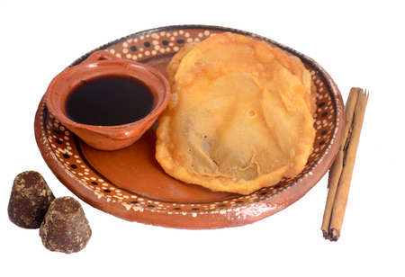 Mexican traditional fried dough buñuelo with piloncillo syrup