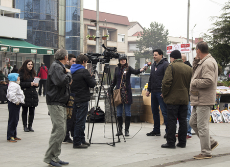 local election: Kavadarci, Macedonia - November 27, 2016: Reporters is interviewing representatives of Macedonian party Levica. Electoral campaign before parliamentary elections in Macedonia on December 2016.