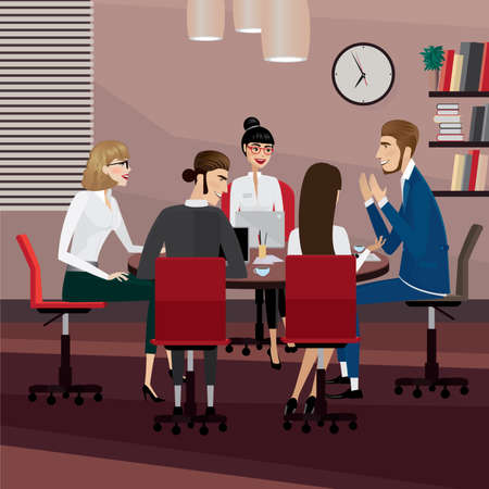 sitting at table: Business men and women at meeting in office