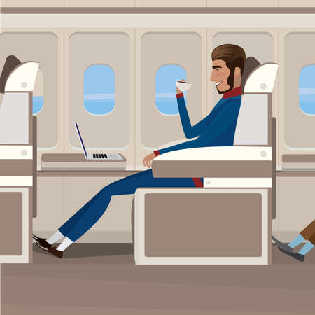 business meeting: Man in business class drinking coffee and looking at a laptop - comfort and luxury concept