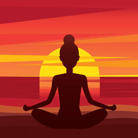 Girl meditating in lotus pose at sunset - peace of mind concept