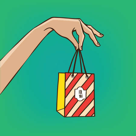 her: Woman extends her hand with the shopping bag - sale or gift concept