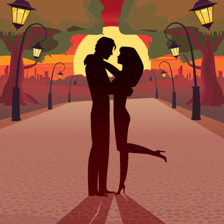 romantic date: Couple hugging in the park at sunset - Romantic date concept