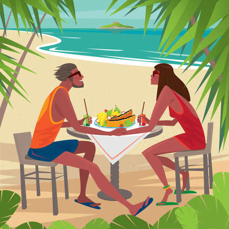 eating lunch: Tanned young couple sitting at a table on a beautiful beach and eating fresh fruits. On the horizon the island - Exotic holidays or Honeymoon concept