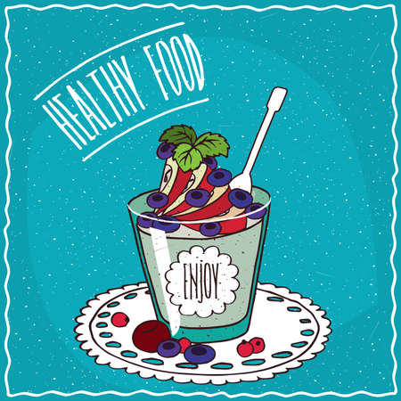Natural yogurt with apple and blueberry in a glass, lie on lacy napkin. Blue background and lettering Healthy food. Handmade cartoon style