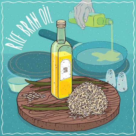 쌀겨 기름과 쌀겨와 줄기의 유리 병. 프라이팬에 손을 붓는 석유. 튀김 용 천연 식물성 기름