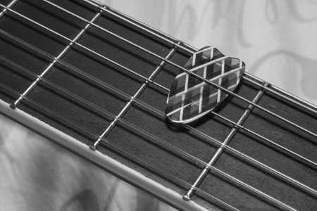 fret: Pick on a guitar fret Stock Photo