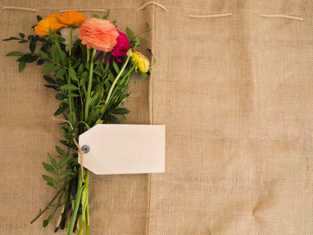 textfield: Beautiful bouquet of flowers with blank textfield and copyspace on jute fabrics