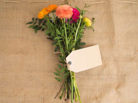 textfield: Beautiful bouquet of flowers with a blank textfield on jute fabrics Stock Photo