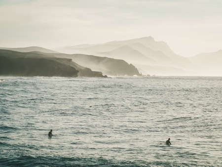 surfers: La Pared - surfers beach in sunset, Fuerteventura, Canary Islands