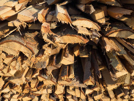 woodcutting: a pile of chopped firewood logs in the sunlight Stock Photo