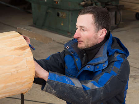 manual measuring instrument: Joiner measures a log Stock Photo