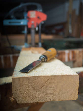 woodcutting: Wooden board with chisel in a wooden workshop