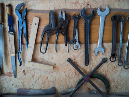 woodcutting: Set of tools on a wood panel