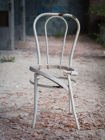 broken chair: Vintage damaged broken chair in an abandoned place