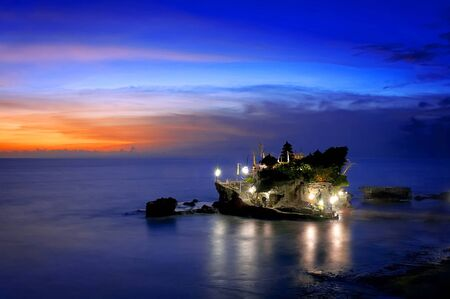 hinduism: A beautiful landscape of hinduism temple located in Tanah Lot Bali during yearly ritual Stock Photo