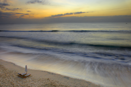 easy chair: Title :  On a Remote Place With Beautiful Sunset  Description :  Simple lounge chairs on the beach