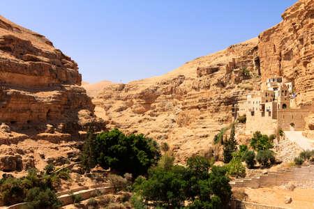 judean hills: The Greek Orthodox Monastery of Saint George in Wadi Qelt, Judean Desert, panoramic Stock Photo