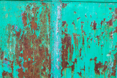 rusty background: Old metal green painted background with streaks of rust.