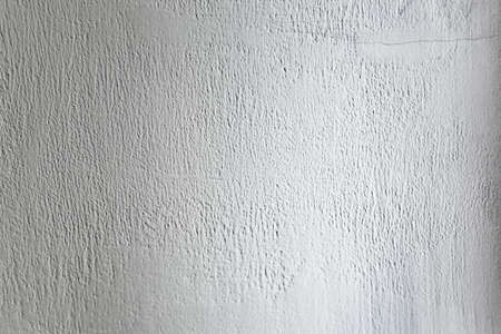 Rough light gray colored surface for backgrounds and textures.