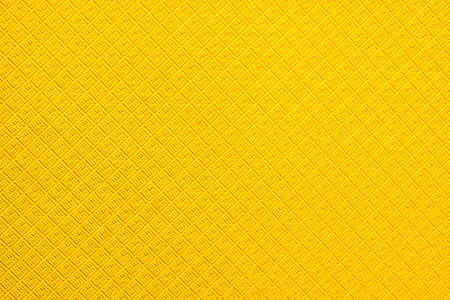 Rough light yellow colored surface for backgrounds and textures.