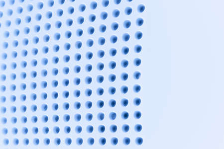 Abstract light colored surface with holes built in a row for creativity, wallpapers and backgrounds.