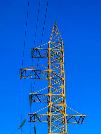 Image of high voltage power line and sky.