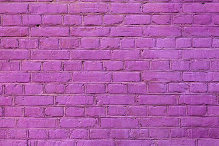 A close-up shot of a pink painted brick wall for creativity, textures and backgrounds.
