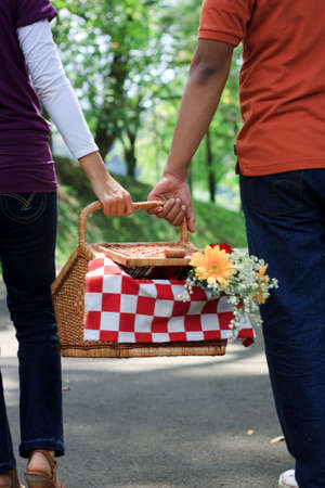 Young loving couple having a picnic outdoors photo