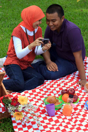 Young loving couple having a picnic outdoors Stock Photo - 8521115