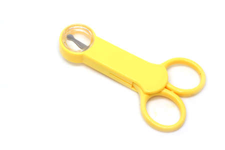 photo of a yellow baby nail clipper, the design is made to make it easier for parents to trim baby nails