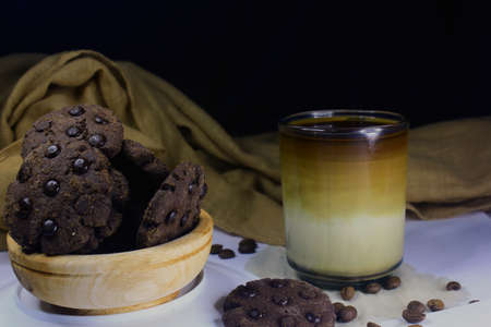 Chocolate granules cookies served with strong Vietnamese drip coffee, bitter coffee and sweet cookies are best served when relaxing such as reading a book or when we need energy