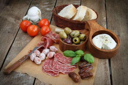 wood cut: various cold meal used in mediterranean countries Stock Photo