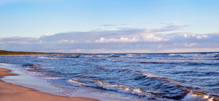 Virgin panoramic seascape with clouds and small waves in Baltic sea