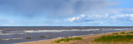 Virgin panoramic seascape, coast with clouds and small waves in Baltic sea Zdjęcie Seryjne
