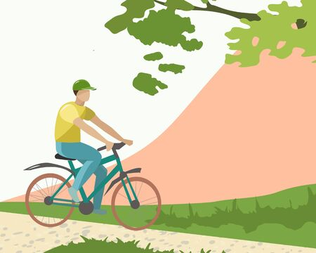 A young man rides a Bicycle in the Park